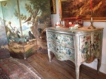 Venetian 18th century commode and Dutch painted folding screen depicting cranes, pheasants and ducks - in the Dining Room at Bentley